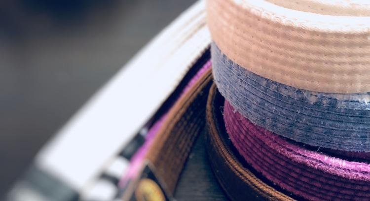 My jiu jitsu belts. White, blue, purple, and brown.